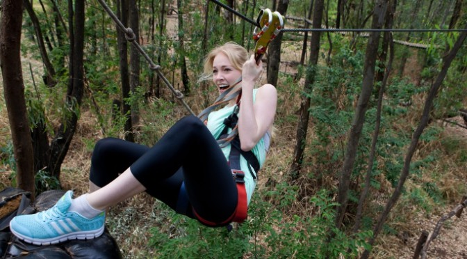 Happy lady on a zipline